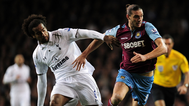 Tom Huddlestone and Andy Carroll compete for possession