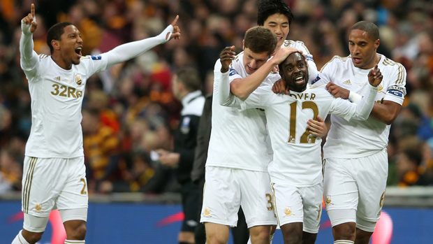 Nathan Dyer is congratulated by his Swansea team-mates after scoring against Bradford in the League Cup Final