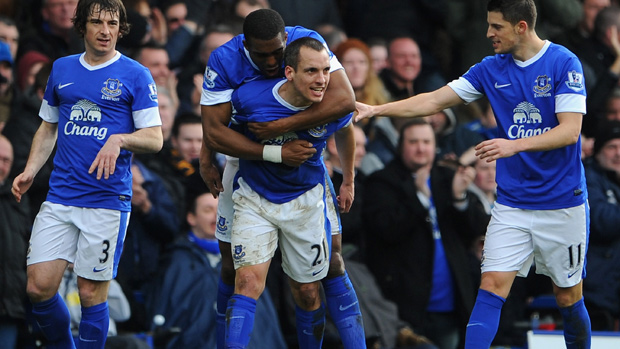 Leon Osman is congratulated by his Everton team-mates after scoring against Manchester City