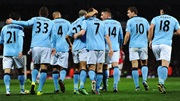 Manchester City players celebrate James Milner's goal against Arsenal