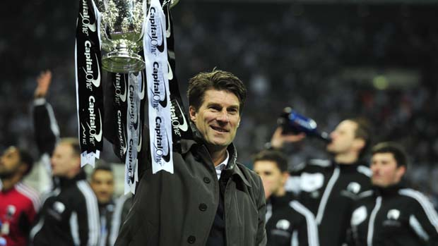 Swansea City manager Michael Laudrup celebrates winning the League Cup at Wembley.