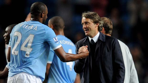 Manchester City's Patrick Vieira is congratulated by his manager Roberto Mancini in 2011.