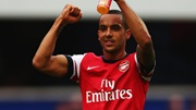Theo Walcott celebrates Arsenal's win at QPR