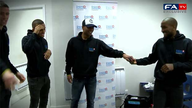 England stars Ashley Cole and Jermain Defoe take the Keepy Uppy Challenge.