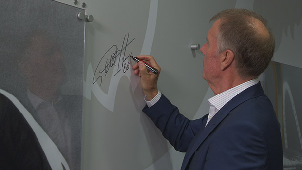 Sir Geoff Hurst signs his name at St. George's Park