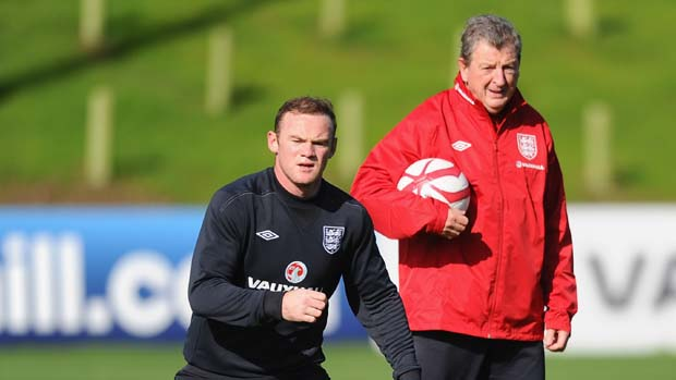 England Manager Roy Hodgson watches Wayne Rooney train at St. George's Park