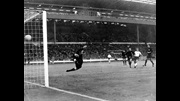 Bobby Charlton scores against Mexico in 1966.