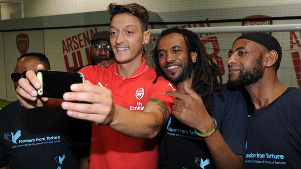 Mesut Ozil takes time out for a selfie